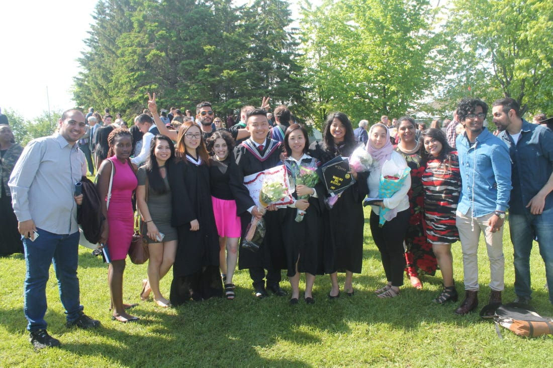 Students at Algoma University, including former refugees sponsored to Canada through the Student Refugee Program, celebrate their graduation. Canada 2017.
